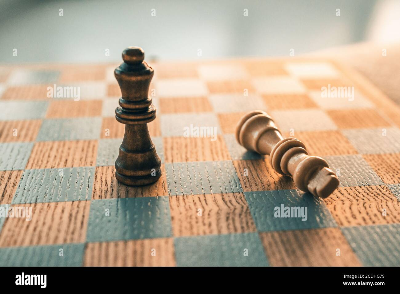 Chess game winning concept. Victory move with last piece standing on chessboard wooden board Stock Photo