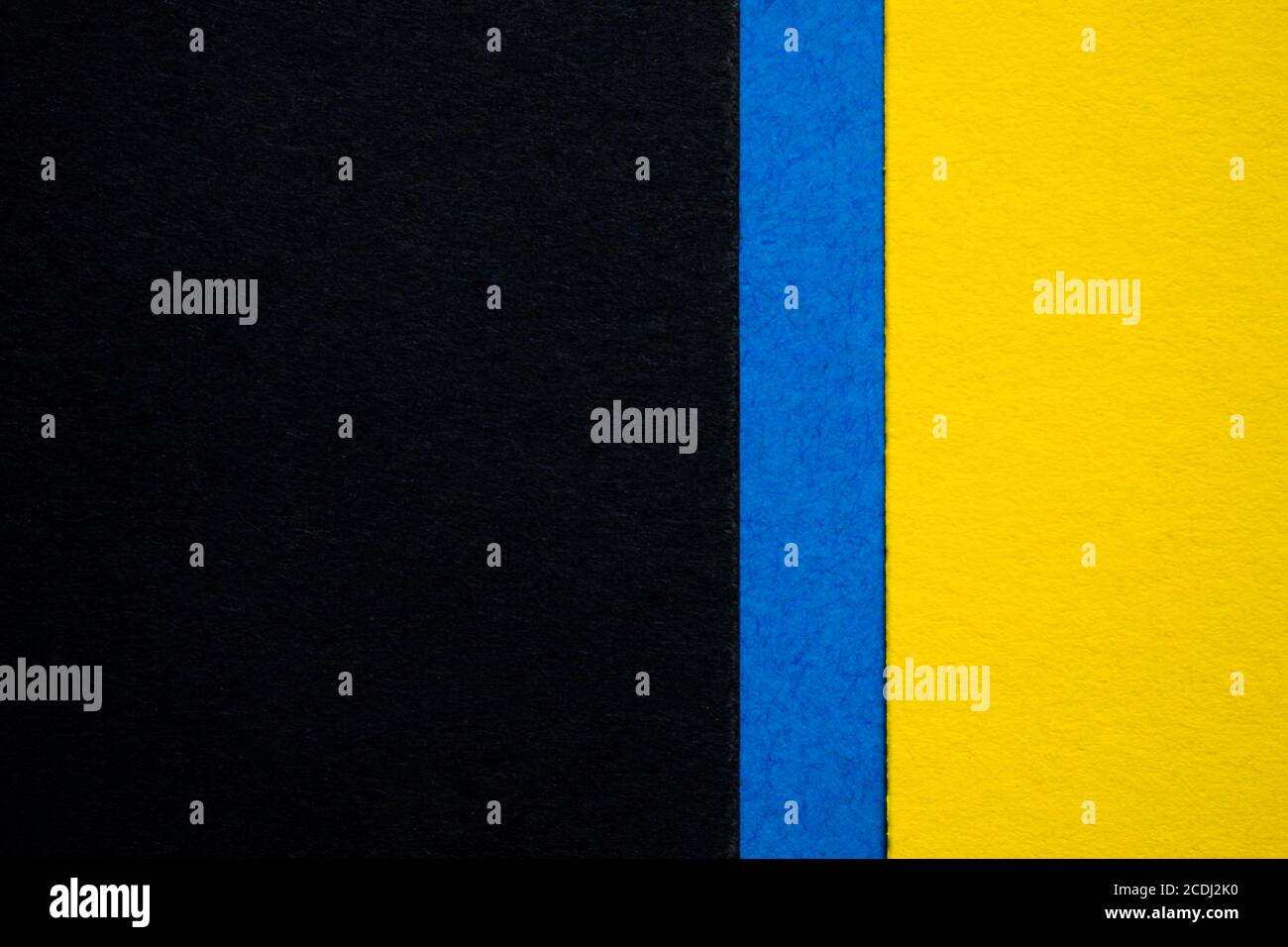 Yellow And Black Colored Paper Background Wallpaper Divided With Blue Stripe Stock Photo Alamy