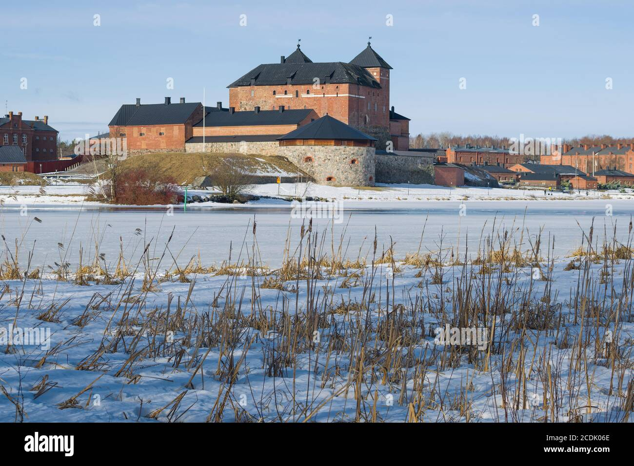 View of the ancient fortress of the Hameenlinna city from the shores of Vanajavesi lake on a March day. Finland Stock Photo