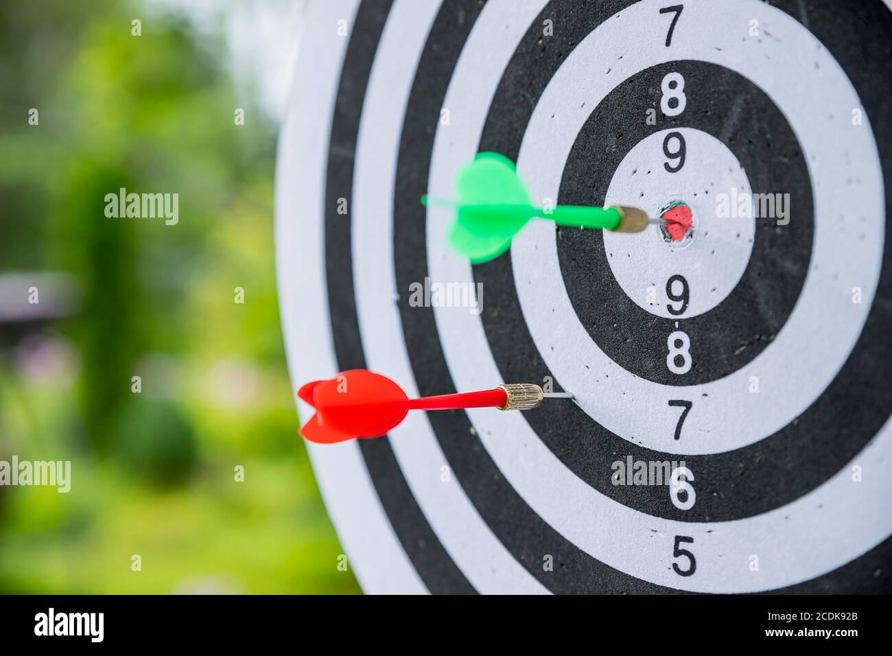 Dartboard with darts. side view of Dartboard with two darts.successful attempt. To attempt difficult task.Dart in bullseye of dartboard concept for Stock Photo
