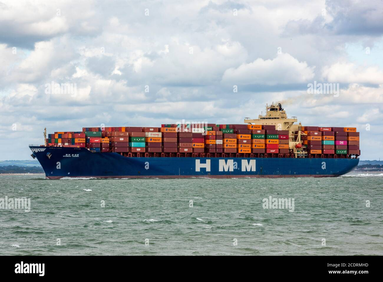a large container cargo ship entering the solent and the port of southampton docks on the south coast of england, Stock Photo