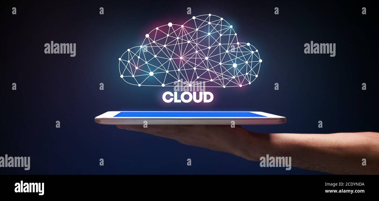 Cloud Data Storage Technology. Man Holding Digital Tablet With Polygonal Cloud Hologram Stock Photo