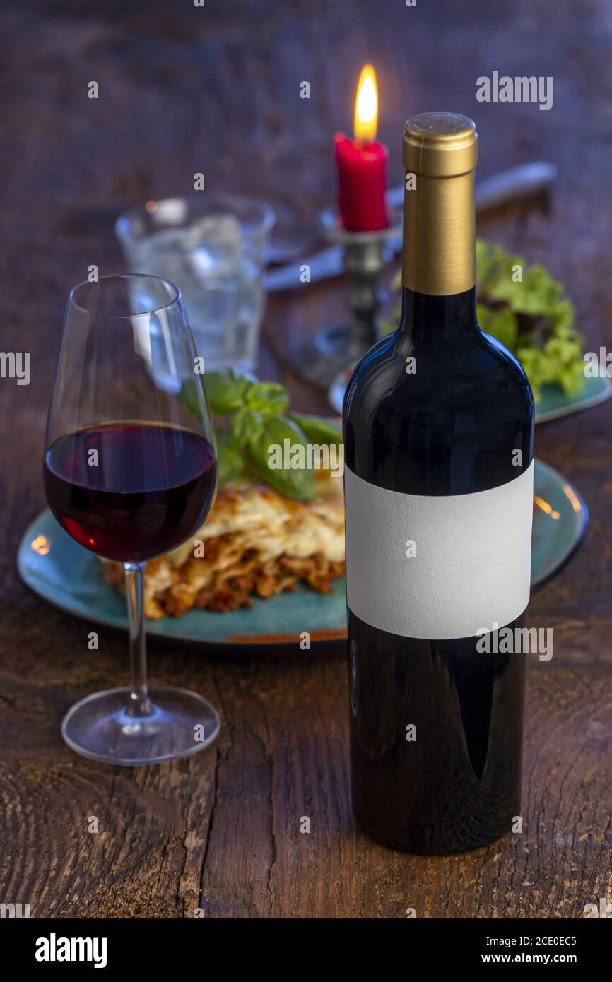 Red wine and lasagne on wood Stock Photo