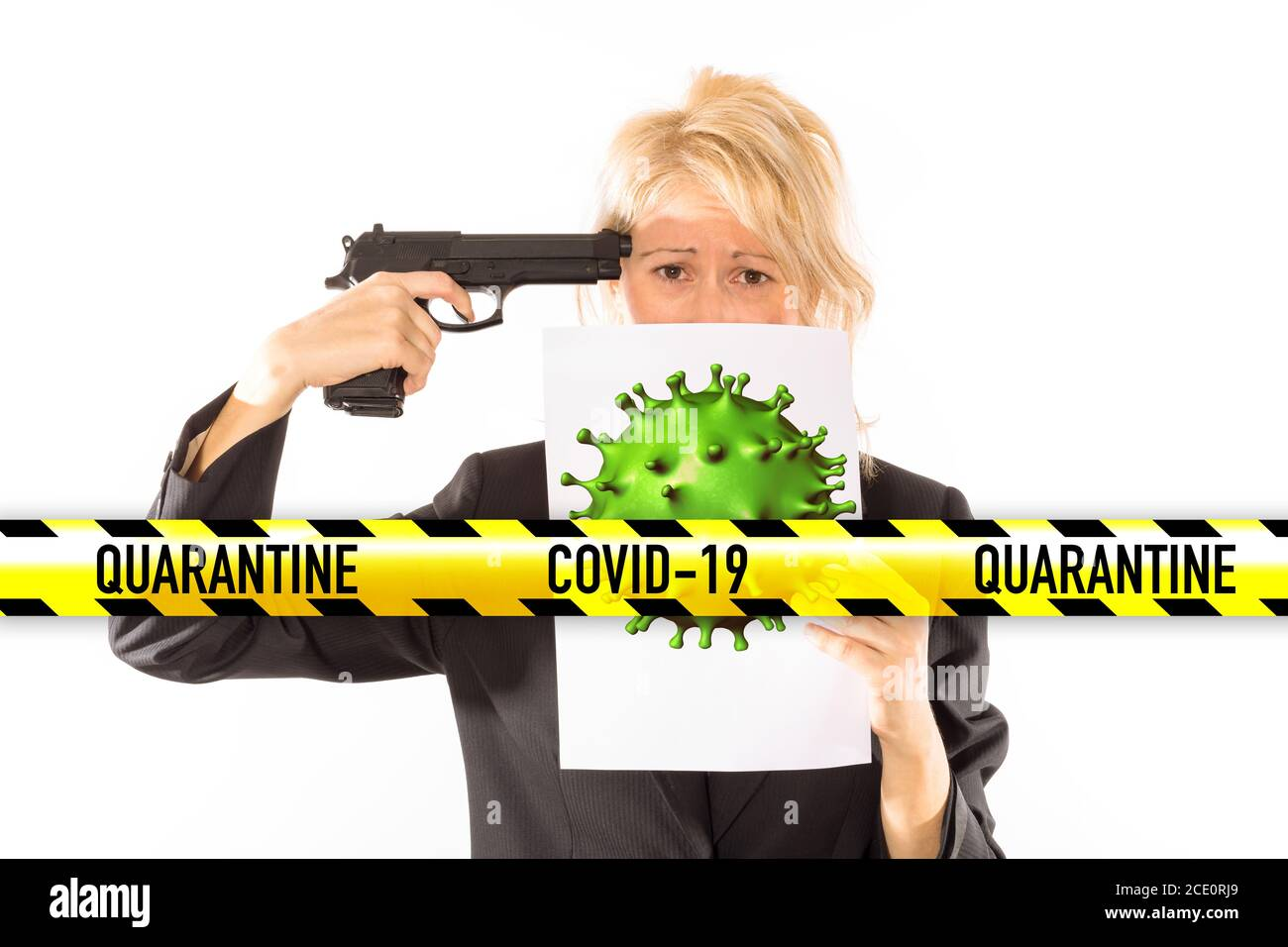 Depressed businesswoman with a gun aimed at her head for the Covid-19 quarantine. Concept of losing the job, company bankruptcy, coronavirus stress Stock Photo