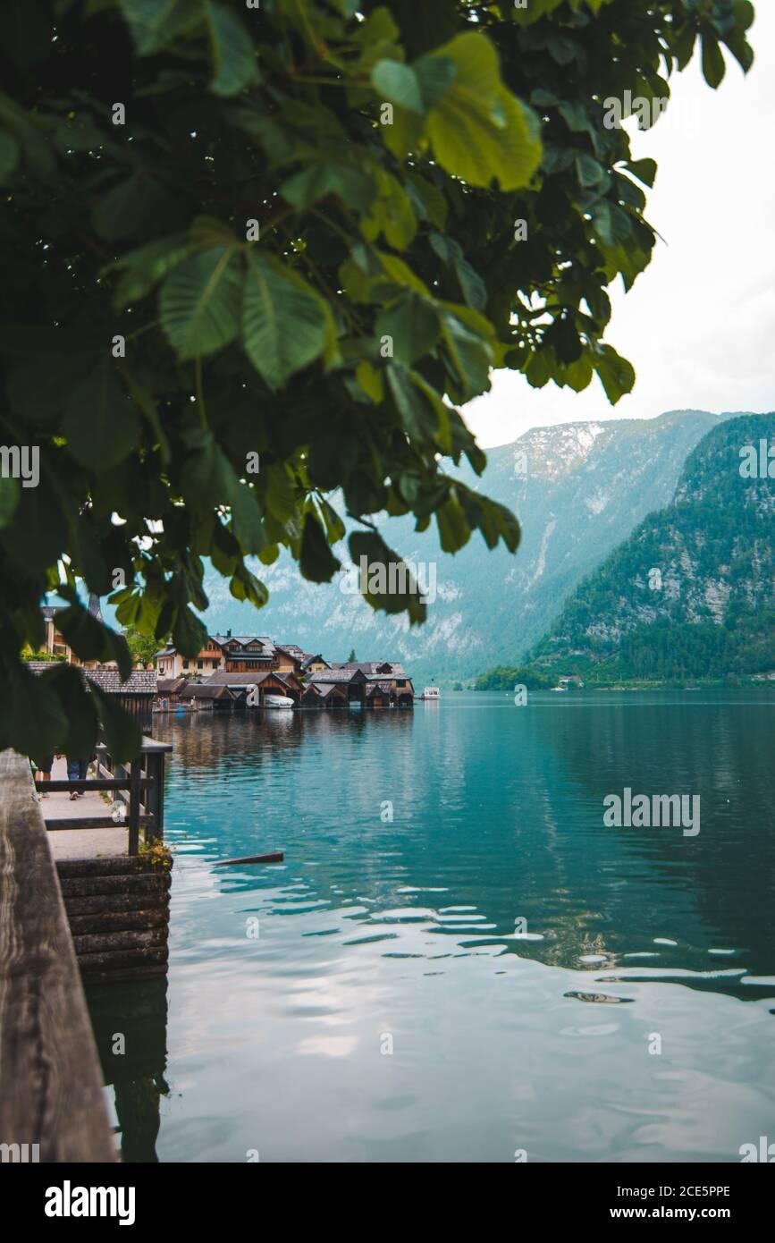 hallstatt city quay with beautiful view of lake and alpine range Stock Photo