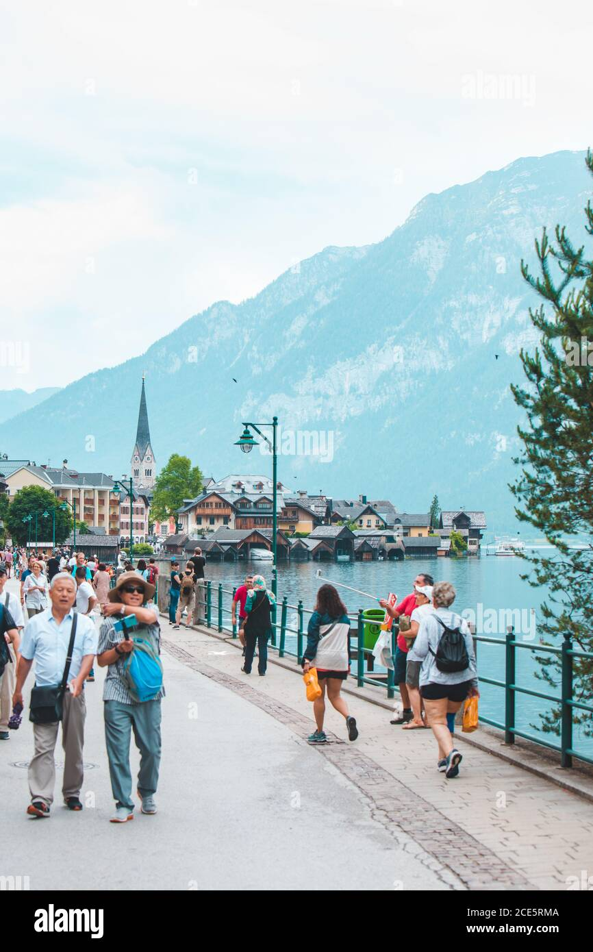 Hallstatt, Austria - June 15, 2019: people walking by city quay enjoying the view Stock Photo