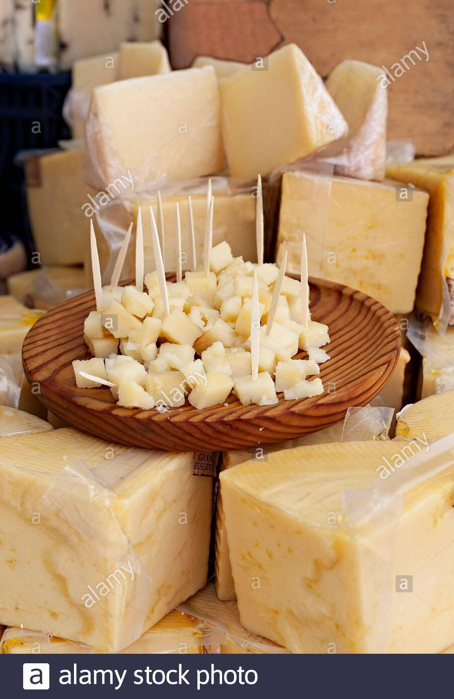Sale of cheese in a market and a plate to try the product for free. Food. Stock Photo