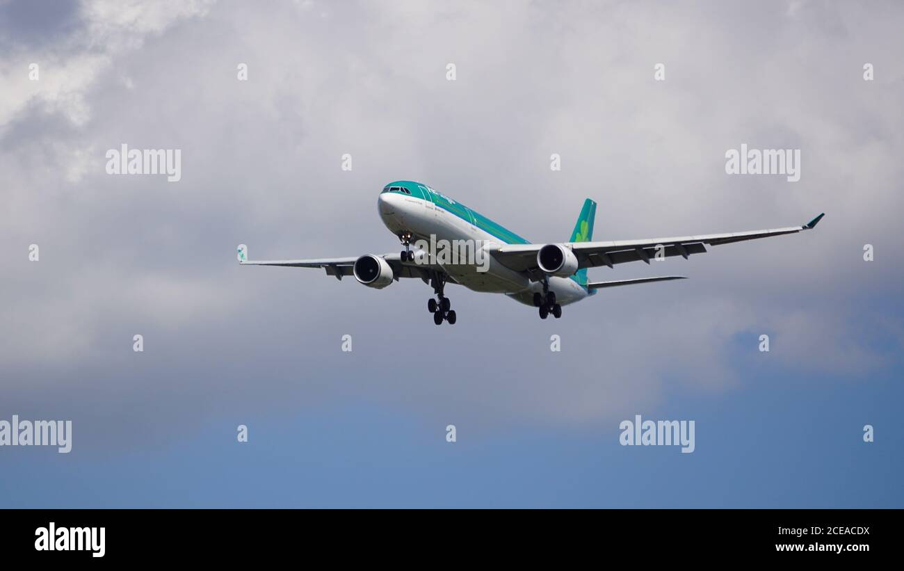 Aer Lingus Airbus A330-302 prepares for landing at Chicago O'Hare International Airport. The plane's registration is EI-FNH and has a retro livery. Stock Photo