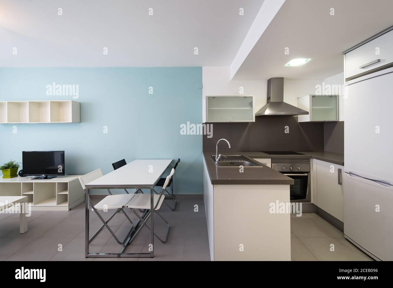 Small Kitchen Zone In Modern Studio Apartment With Nice Furniture Stock Photo Alamy