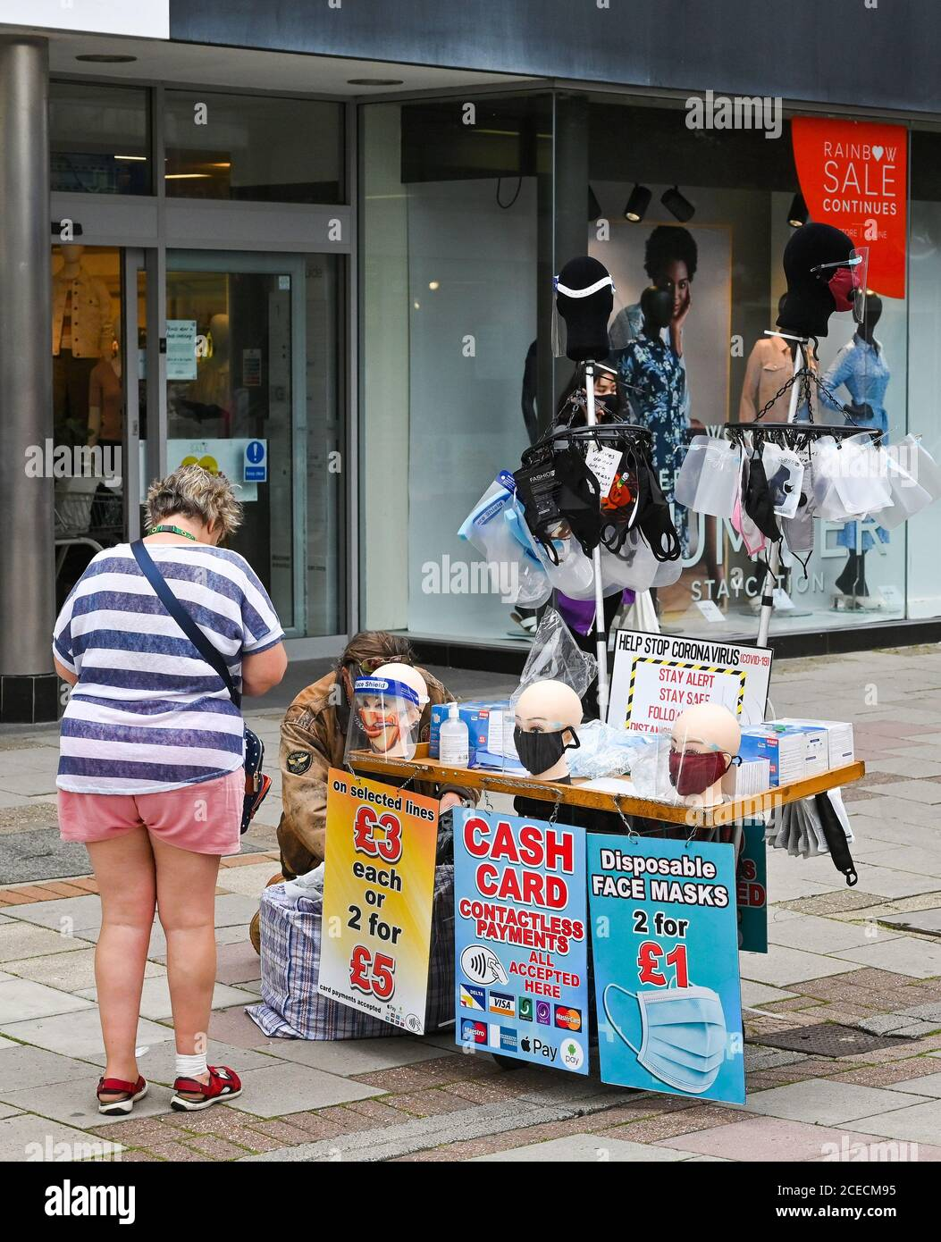 Stall selling coronavirus face masks and coverings in Montague Street Worthing West Sussex UK part of the new normal in England Stock Photo