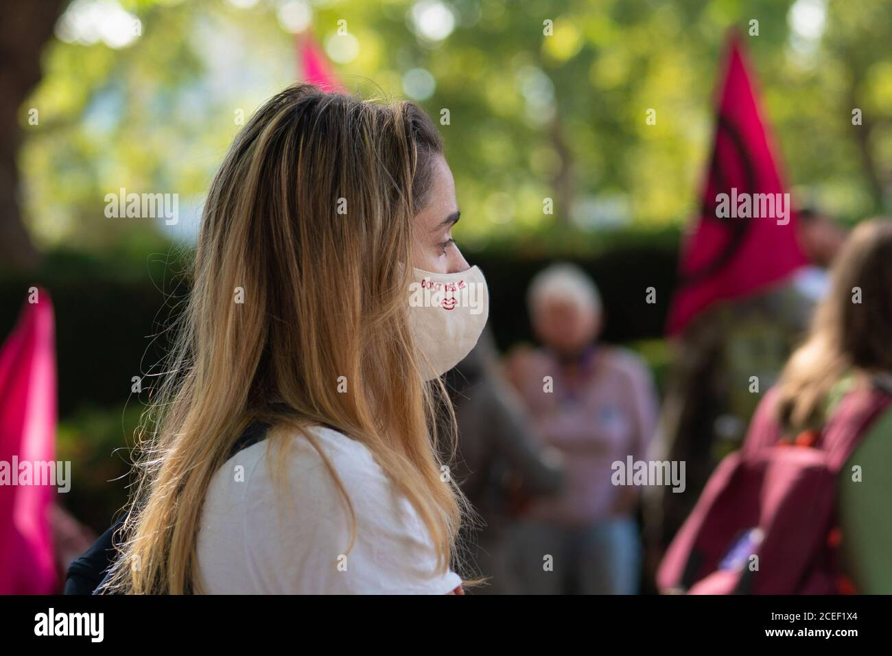 London, UK. Tuesday, September 1, 2020. A protester at an Extinction Rebellion rally in London wearing a mask that says DonÕt Kiss Me Bill. Photo: Roger Garfield/Alamy Live News Stock Photo