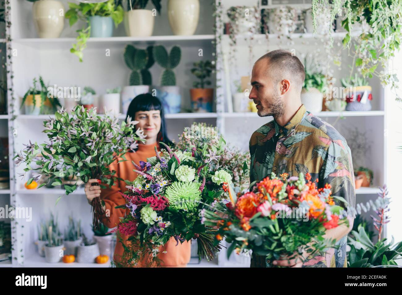 Man And Woman Carrying Bouquets In The Flower Shop Florist Small Business Creative Work Stock Photo Alamy