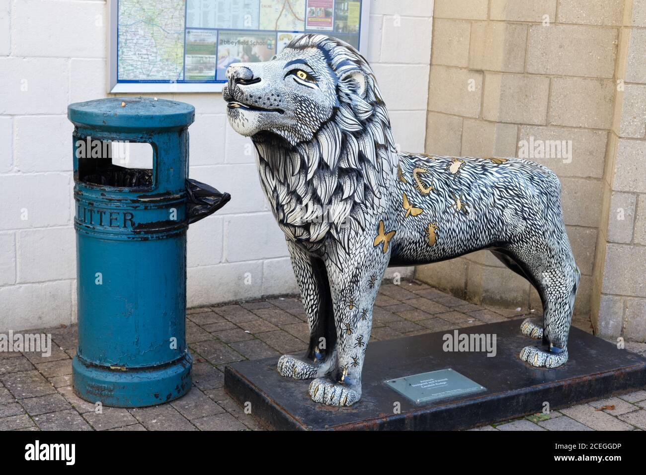 Lion sculpture in historic street and buildings in town centre of Corsham, Wiltshire, England, UK Stock Photo