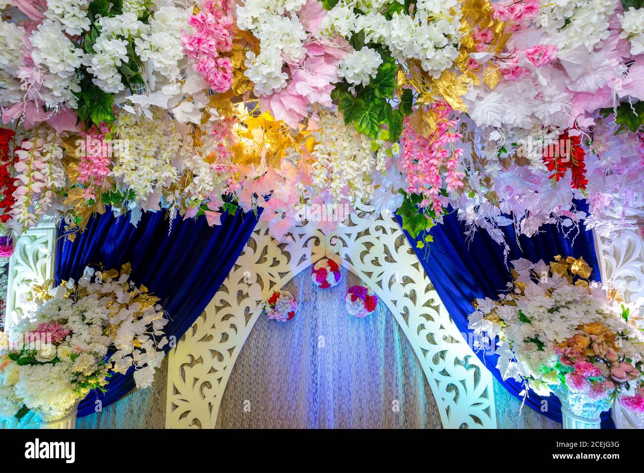 Wedding stage decoration with artificial colorful flower decoration. Stock Photo