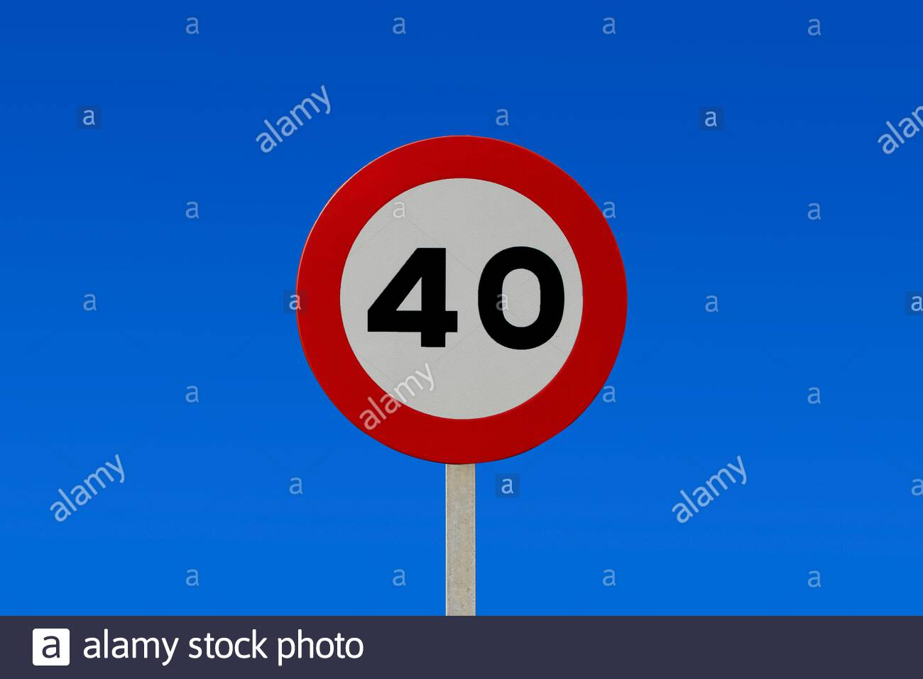 Traffic signs against blue sky - 40km / h speed limit sign with a blue sky in the background Stock Photo