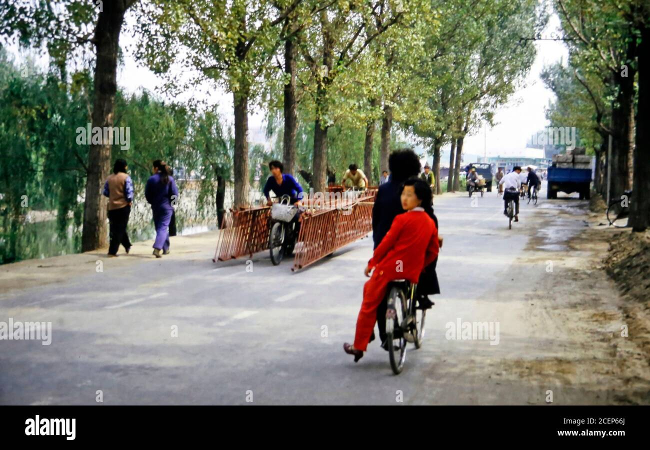 China, 1986, street scene with bicycles Stock Photo