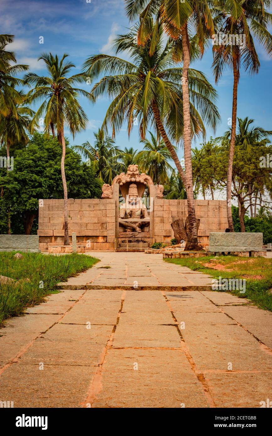 narasimha lakshmi temple hampi antique stone art from unique angle image is taken at hampi karnataka india. This temple features the biggest effigy in Stock Photo