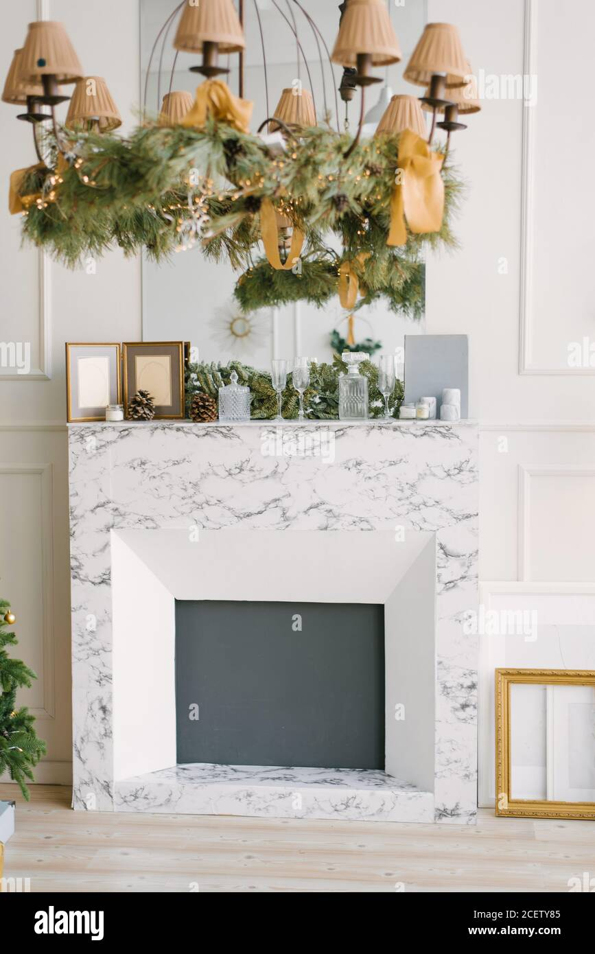 Modern Marble Fireplace In The Living Room Or Dining Room Decorated For The New Year Christmas Tree In The Interior Stock Photo Alamy