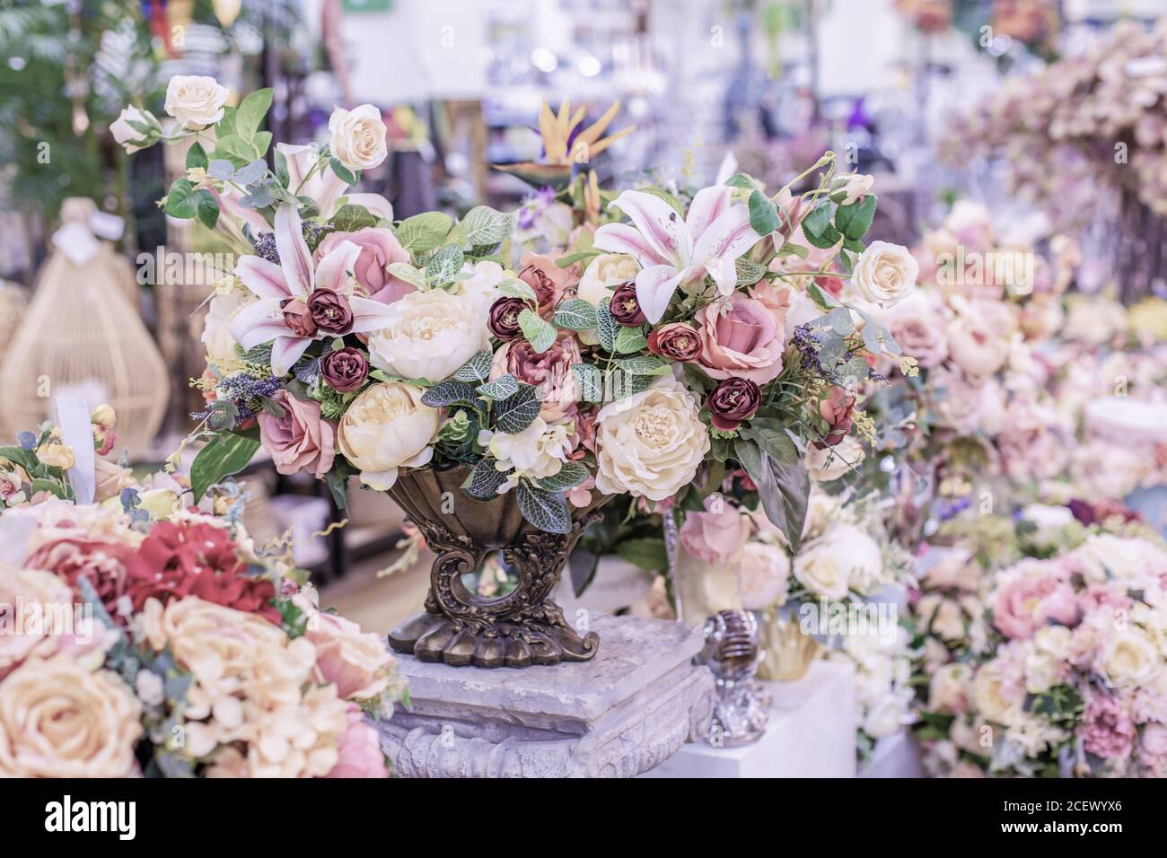 An Elegant Bouquet Of Roses For Home Decor In Pastel Lilac Colors Interior Decoration Artificial Flowers Rose Lily Branch With Green Leaves Romanti Stock Photo Alamy