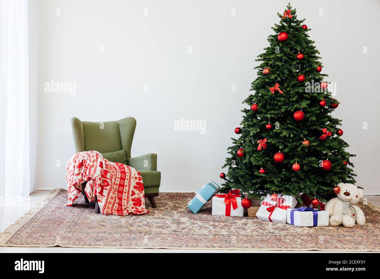 The Interior Of The White Room Is A Green Christmas Tree With Red Gifts For The New Year Decor Stock Photo Alamy
