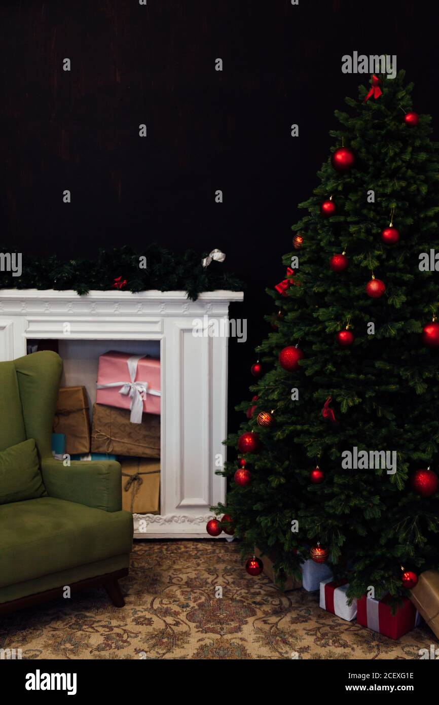 The Interior Of The Black Room Is A Green Christmas Tree With Red Gifts For The New Year Decor Winter Holiday Stock Photo Alamy