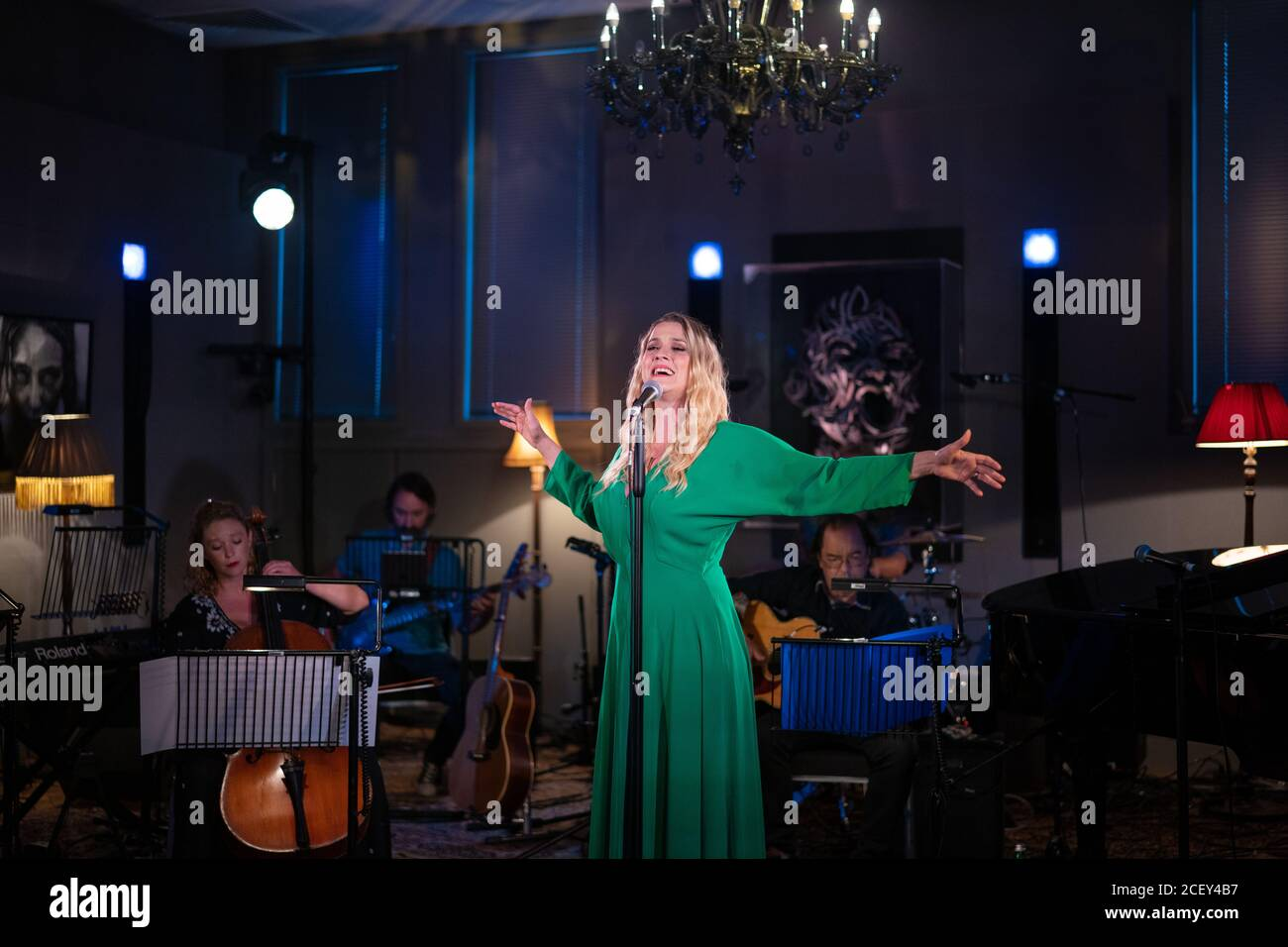 Alice Fearn performing live at L-Acoustics Creation in London as part of West End Unplugged, an initiative to raise money for various charities suppor Stock Photo