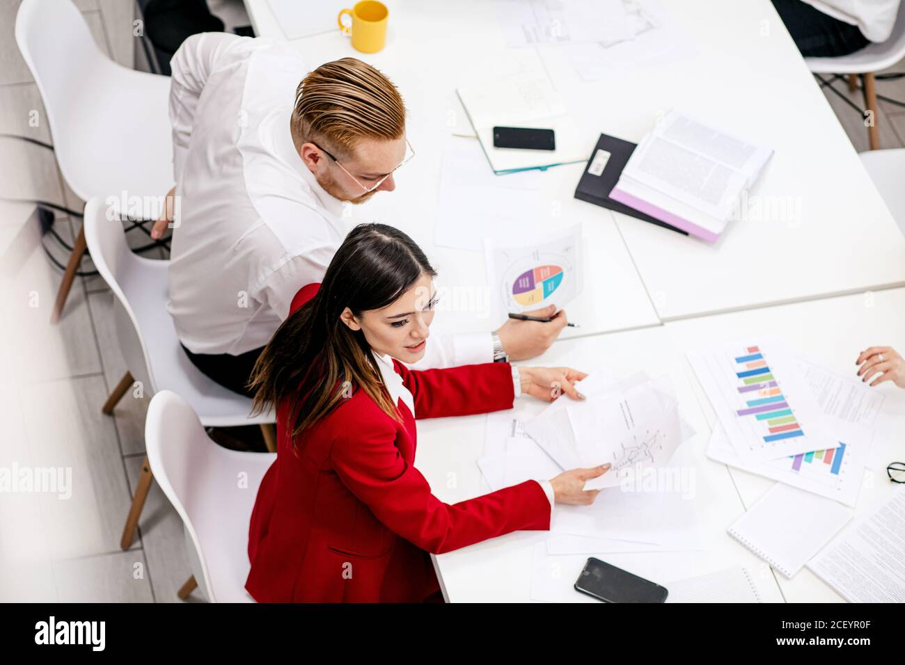 successful creative business team in modern office, young caucasian people business partners conducted meeting for better joint work Stock Photo