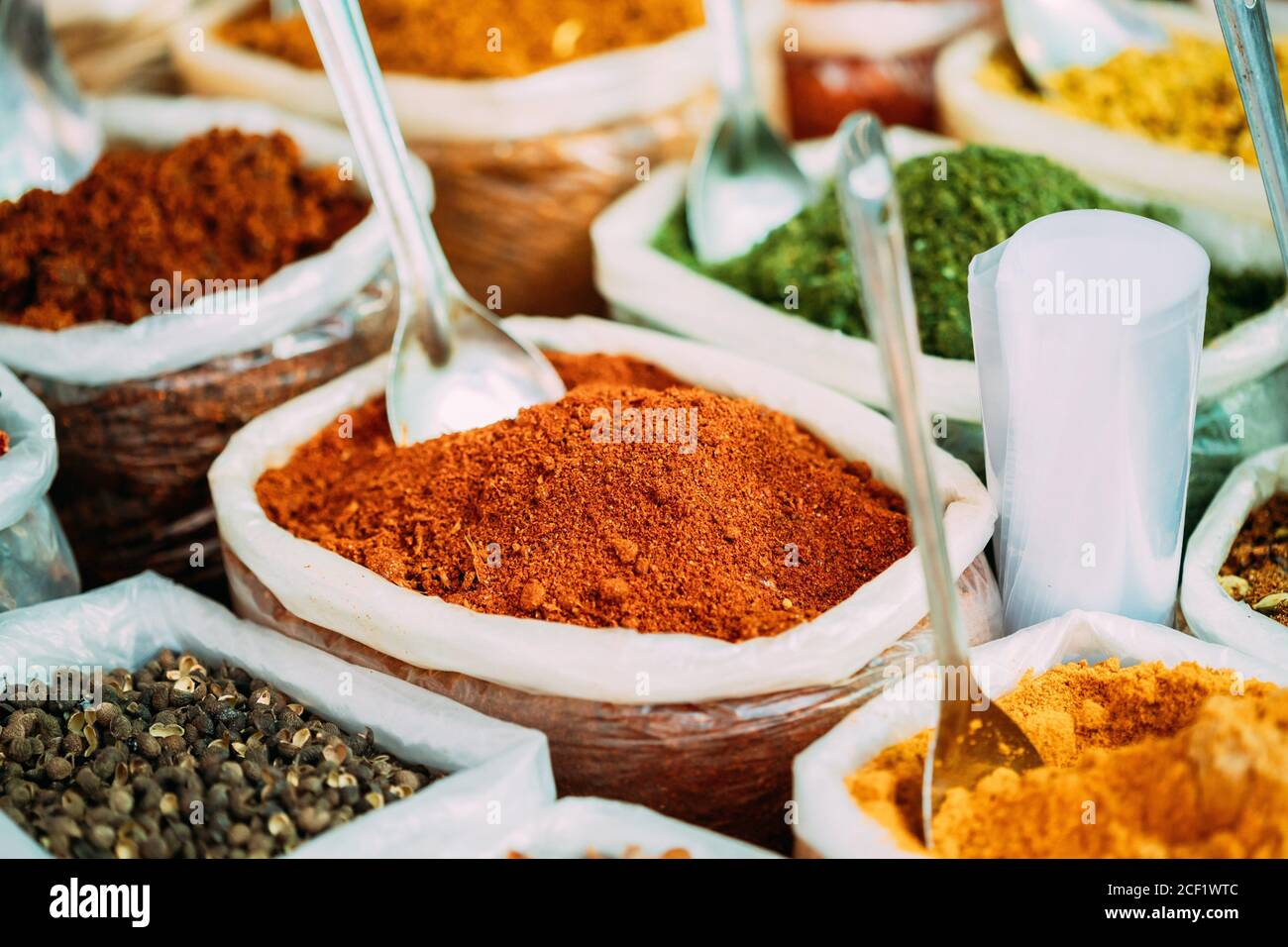 Close View Of Masala Curry, Bright Colors Fragrant Seasoning, Condiment In Bags On Local Food Market, Bazaar. Stock Photo