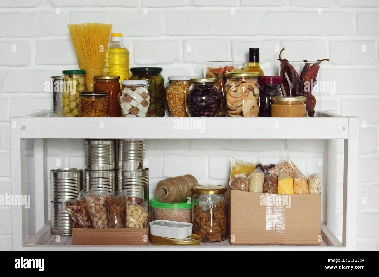 Set Of Long Storage Term Foods On Pantry Shelf Prepared For Disaster Emergency Conditions On Brick Wall Background Stock Photo Alamy