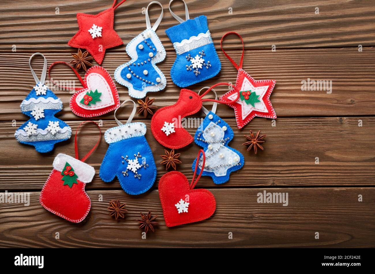 Handmade Rustic Felt Christmas Tree Decorations With Anise On Wooden Table Stock Photo Alamy