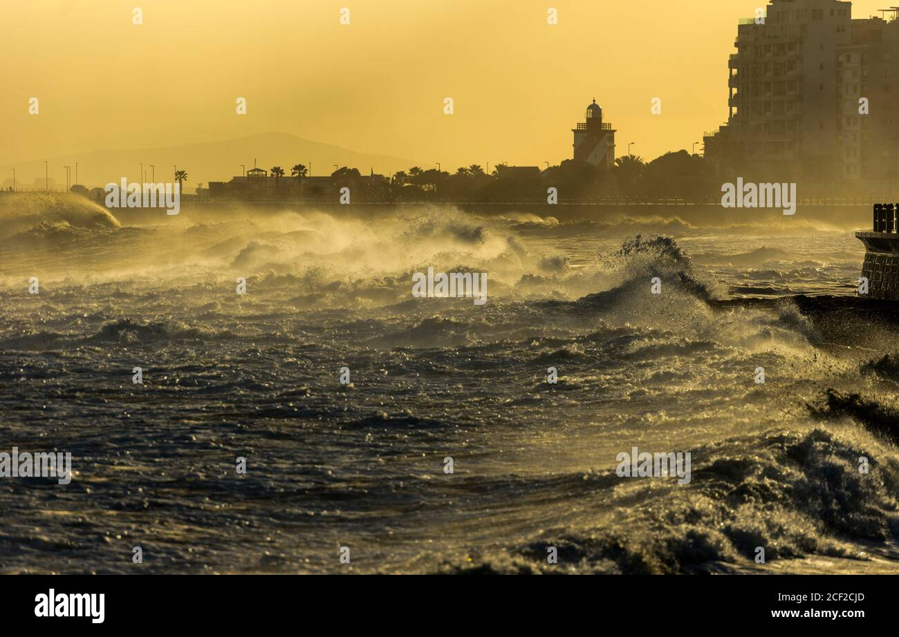 Sepia-toned image of large waves pounding the Sea Point waterfront during a storm. Strong winds turn the  sea into a raging mass of turmoil. Stock Photo