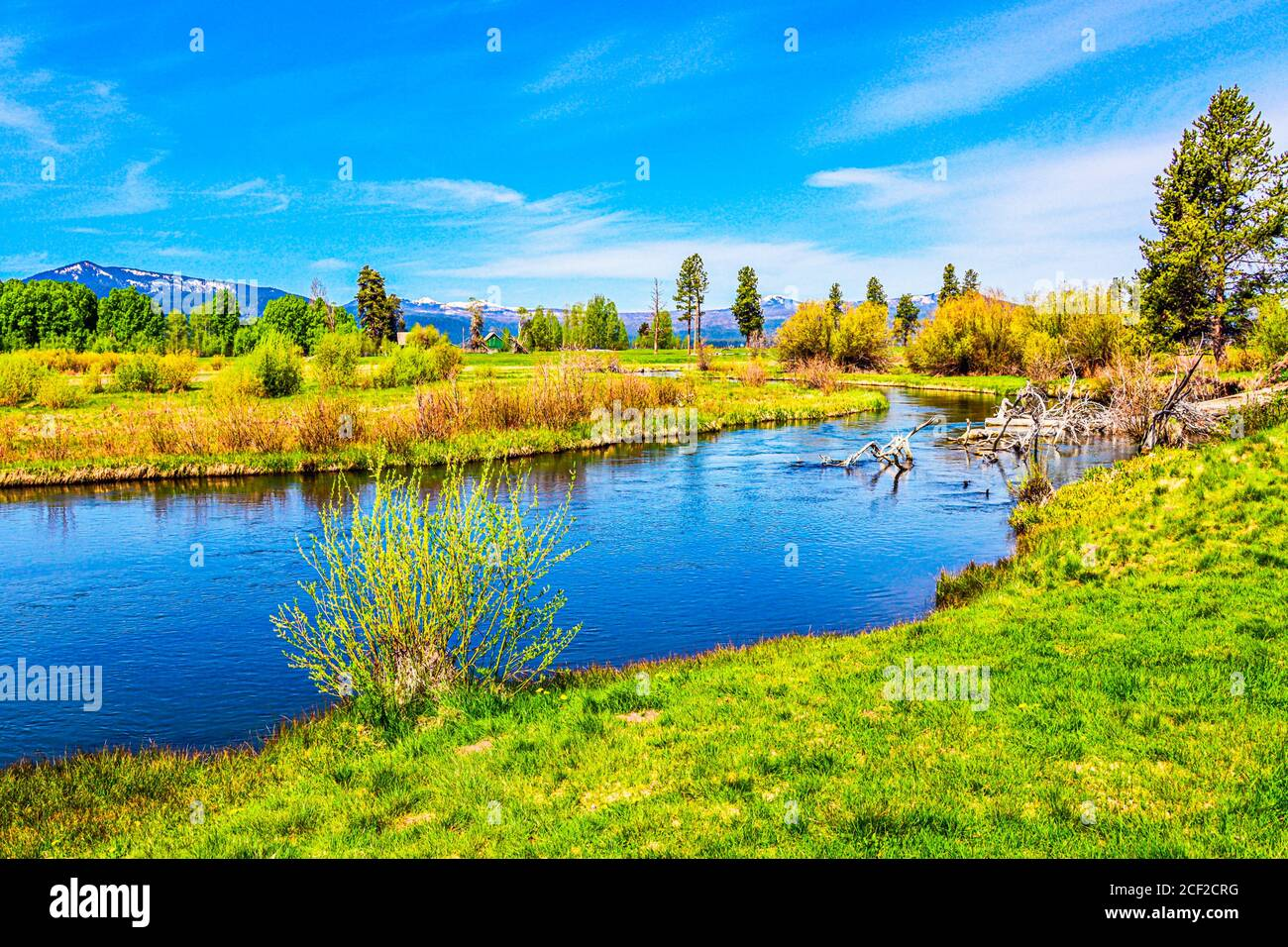 Wood River, southern Oregon. Snow capped mountains of the Cascade Range in the distance. Stock Photo