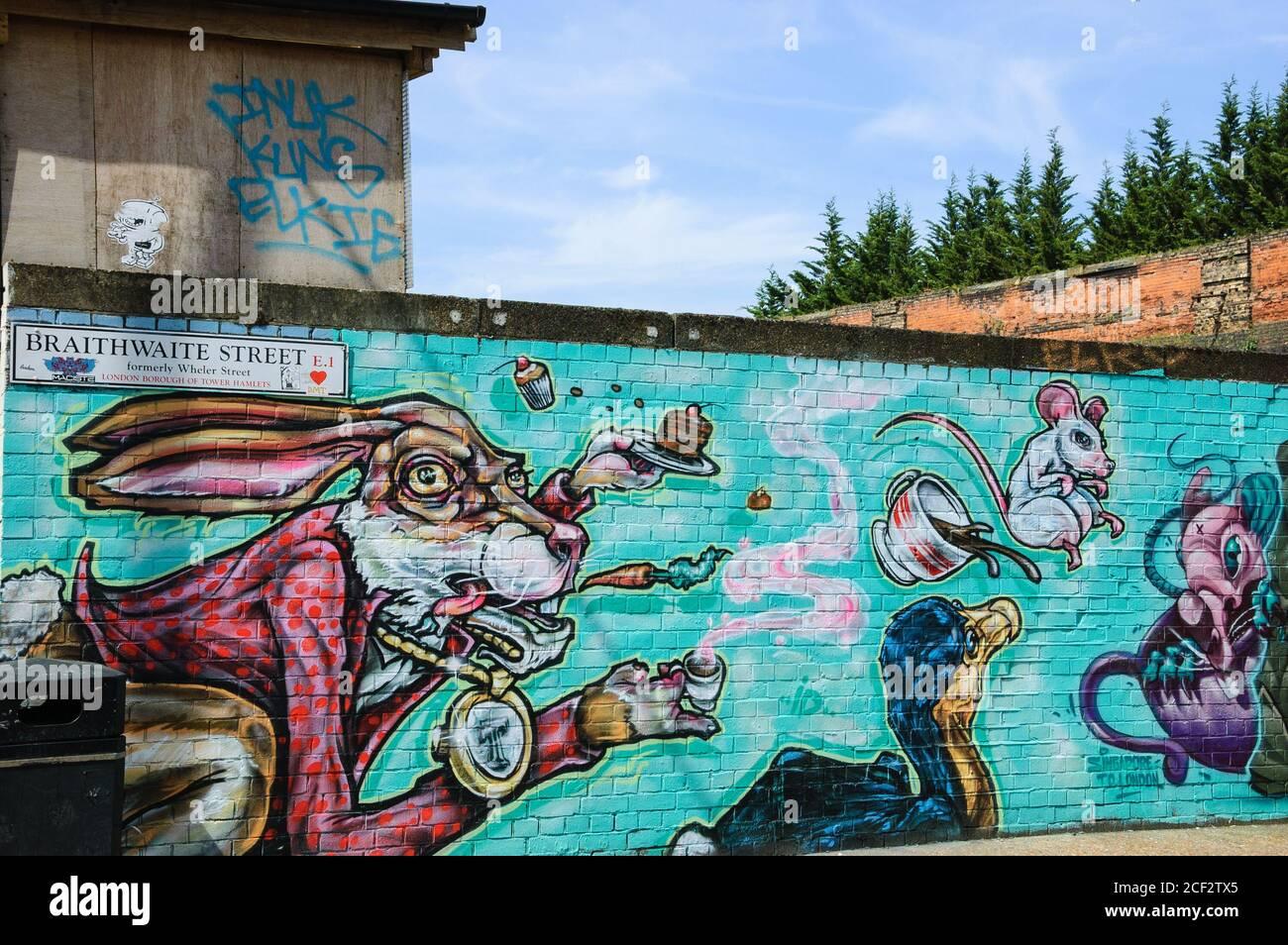 LONDON, ENGLAND, UK - MAY 4, 2014: Graffiti illustration for Alice in Wonderland on the wall in Brick Lane area. Urban art Stock Photo