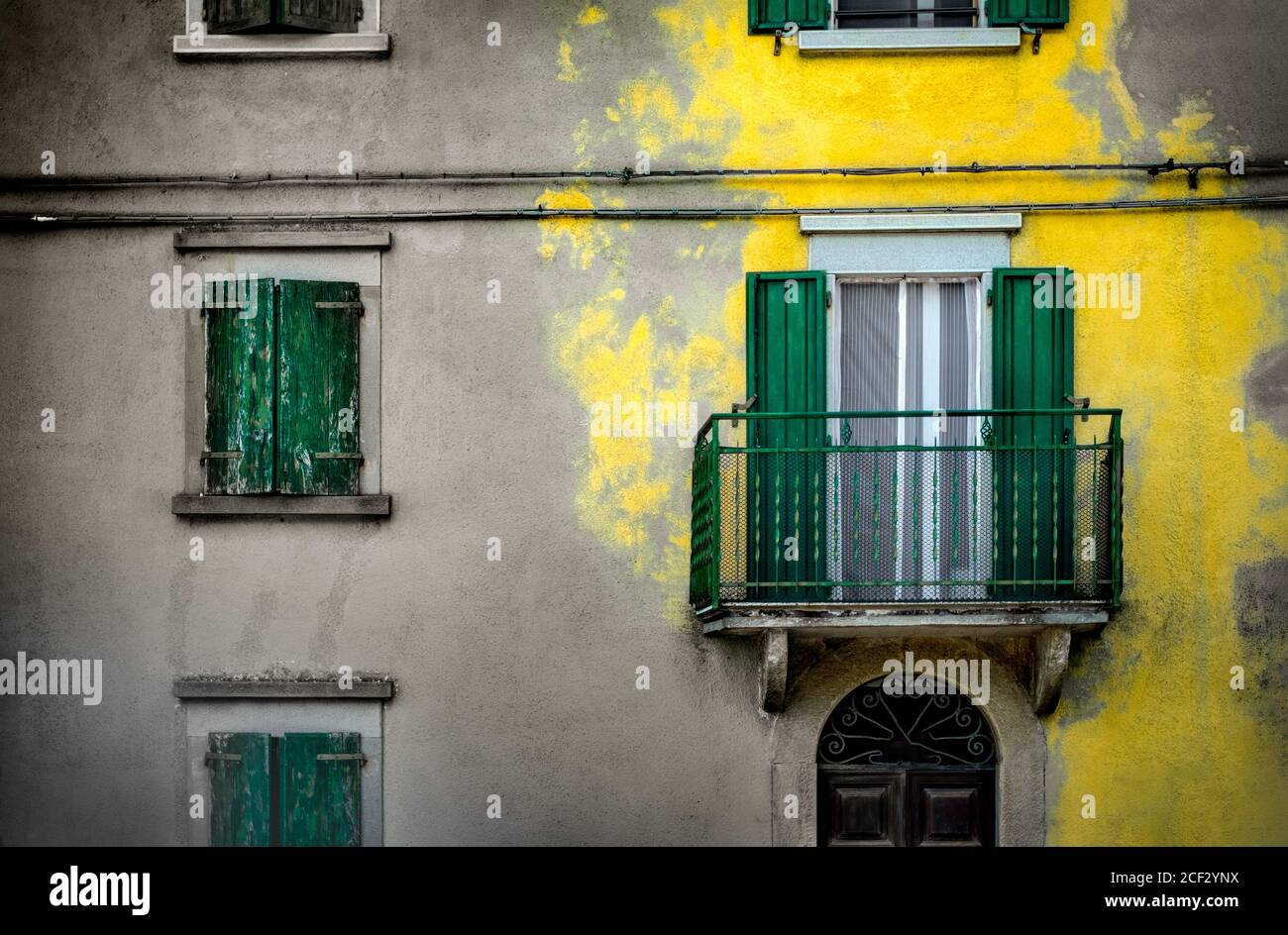 yellow splash color building background yellow plaster paint italian homes background Stock Photo