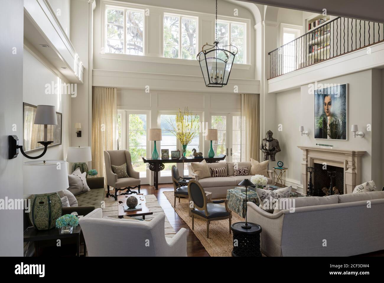 Country Style Living Room With Double Height Ceiling Stock Photo Alamy