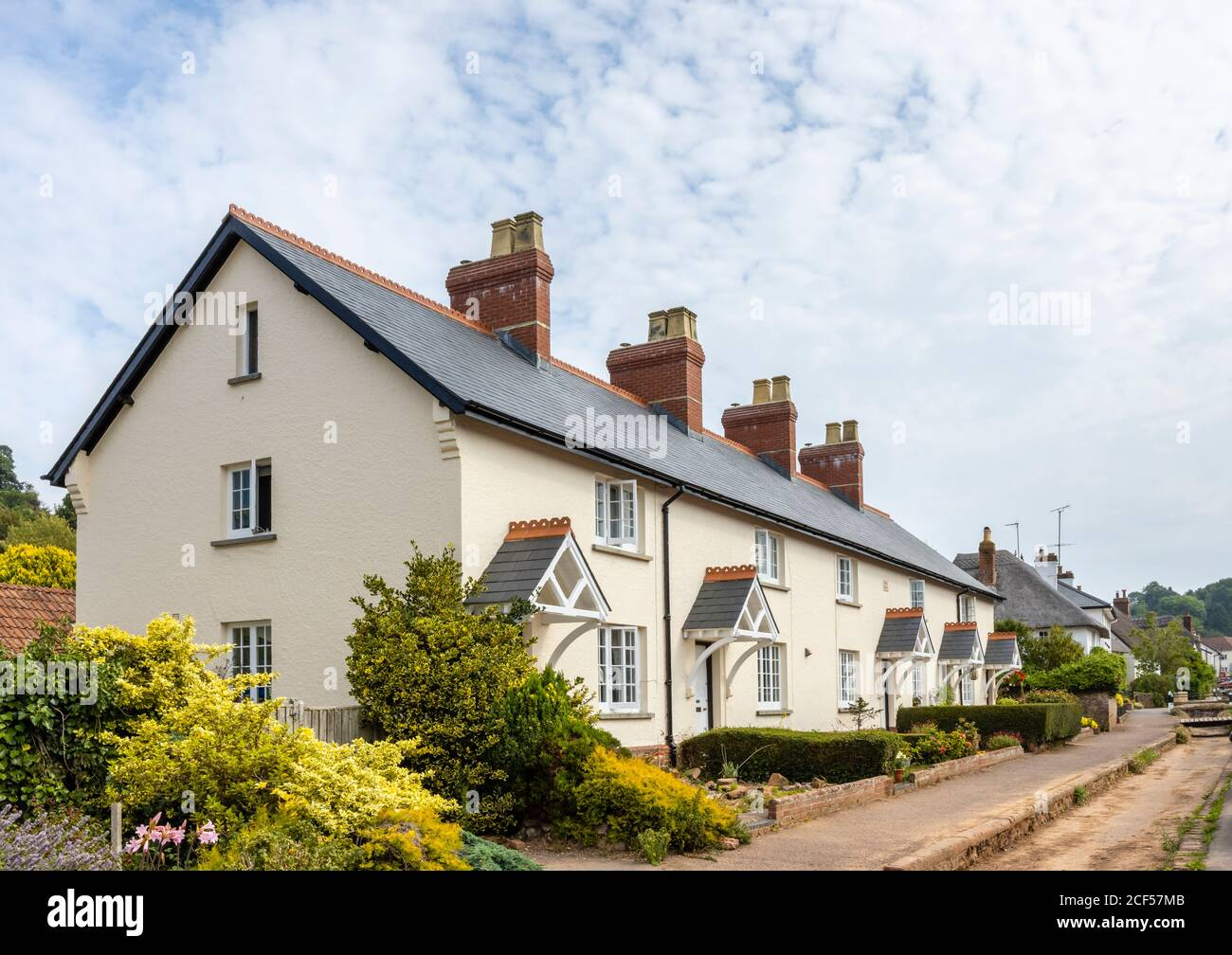 A row of pretty roadside cottages at Otterton, a picturesque quaint small village in the Otter Valley in East Devon, south-west England Stock Photo