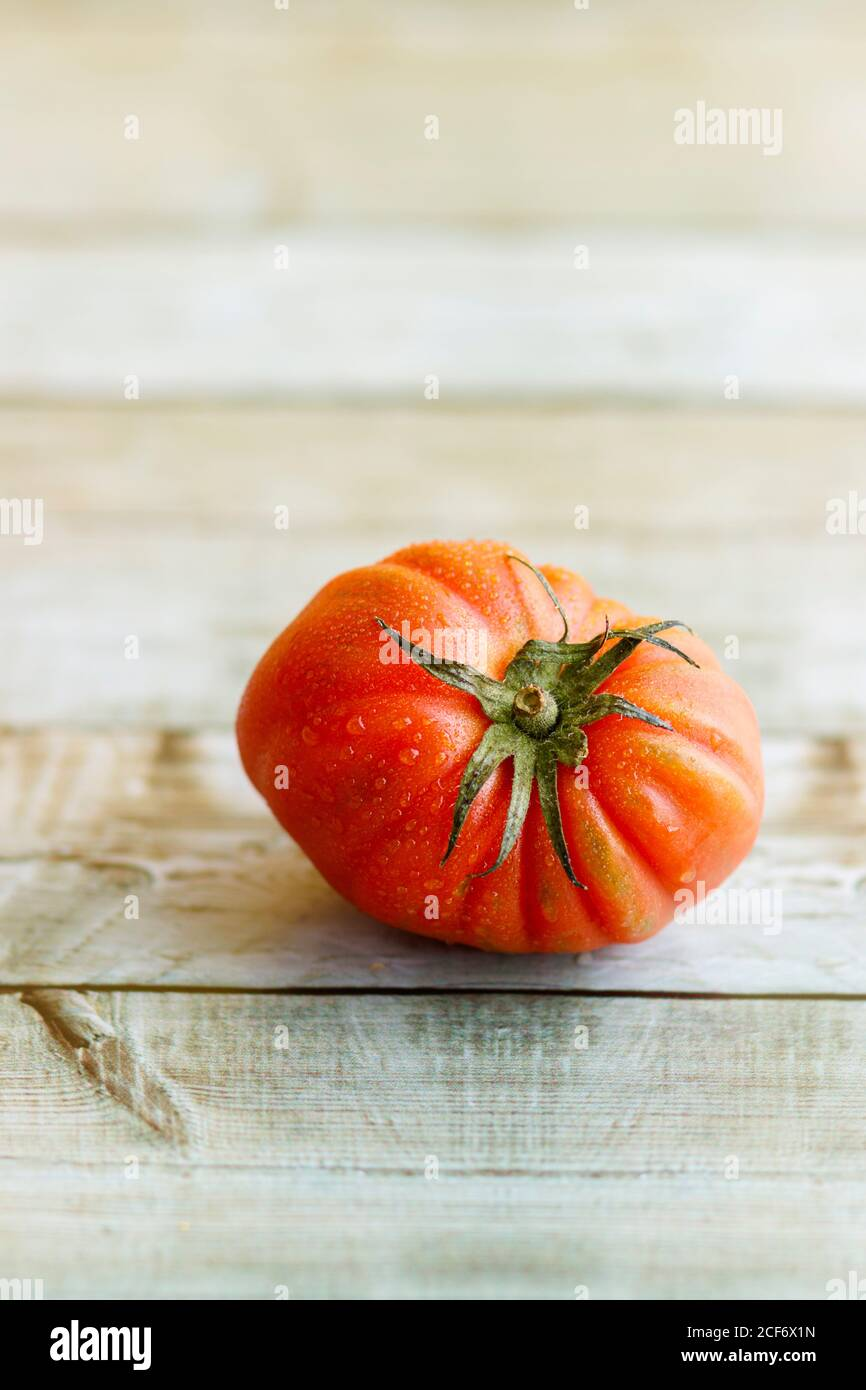 View of beautiful red heirloom tomato on wooden background Stock Photo