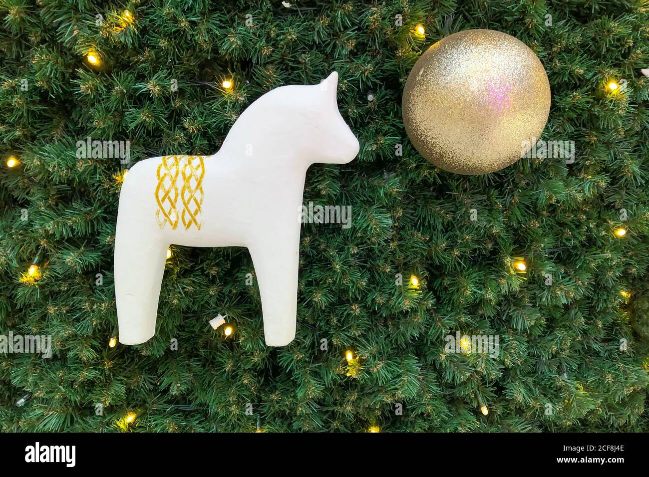 White Wooden Horse And Golden Decorative Ball On The Christmas Tree Festive Christmas Background Backdrop Christmas Decoration Simplicity And Eco F Stock Photo Alamy