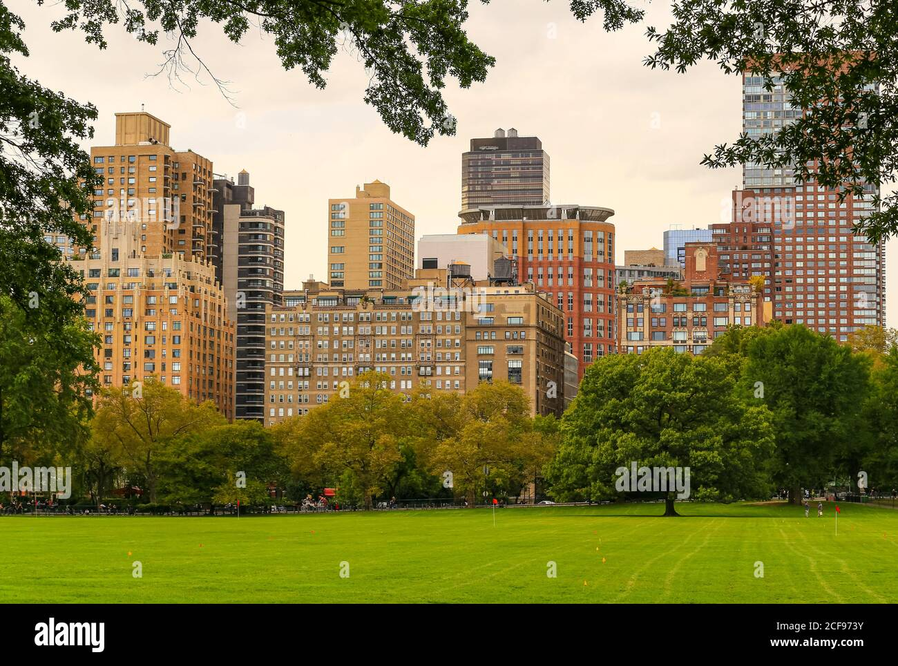 New York City, USA - October 7, 2019: View across the Sheep Meadow in Central Park to the skyline of adjacent buildings near Lincoln Square. Stock Photo