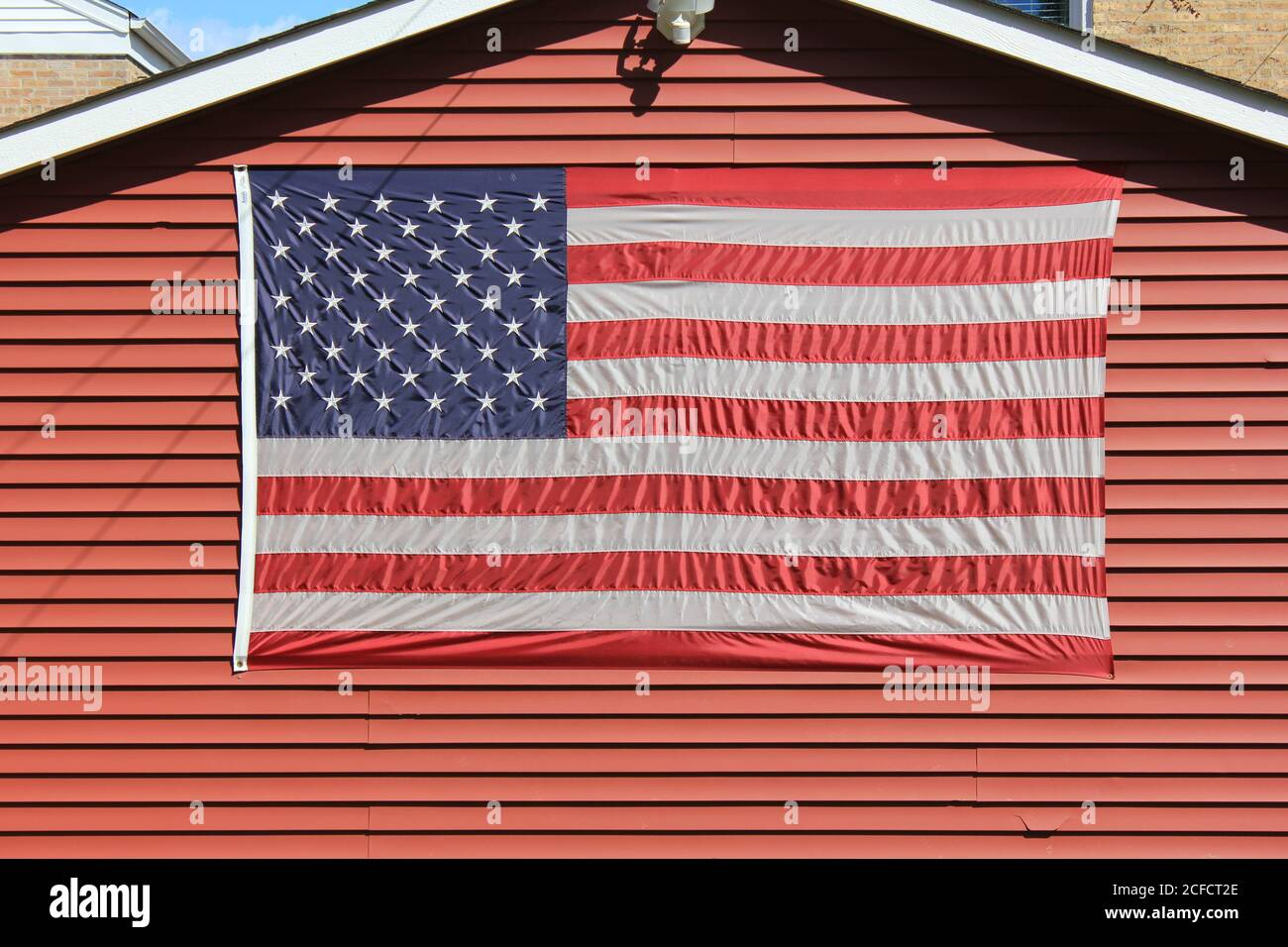 The American Flag on display at a private home at Oriole Park in Chicago, Illinois, USA. Stock Photo