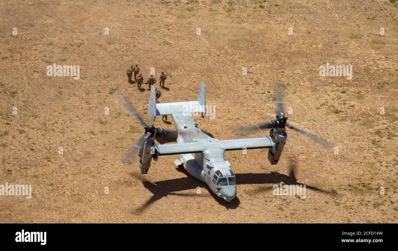 U.S. Marines with 3rd Marine Regiment, 3rd Marine Division, III Marine Expeditionary Force, conduct an aerial insert via MV-22 Ospreys with Marine Medium Tiltrotor Squadron (VMM) 363 during a Marine Air-Ground Task Force demonstration at Marine Corps Training Area Bellows, Hawaii, Sept. 1, 2020. Esper made the visit to view a Marine Air-Ground Task Force demonstration, incorporating elements of aviation, ground, and amphibious capabilities. (U.S. Marine Corps photo by Cpl. Eric Tso) Stock Photo
