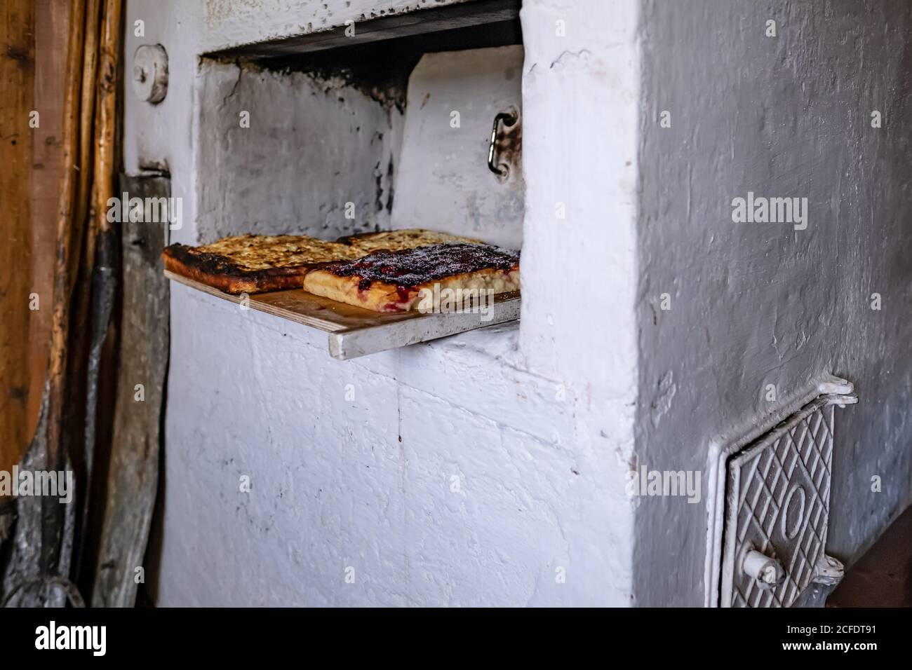 Pies Cooked In A Traditional Russian Oven On A Cutting Board Next To The Wall There Are Old Kitchen Utensils In A Village House Stock Photo Alamy