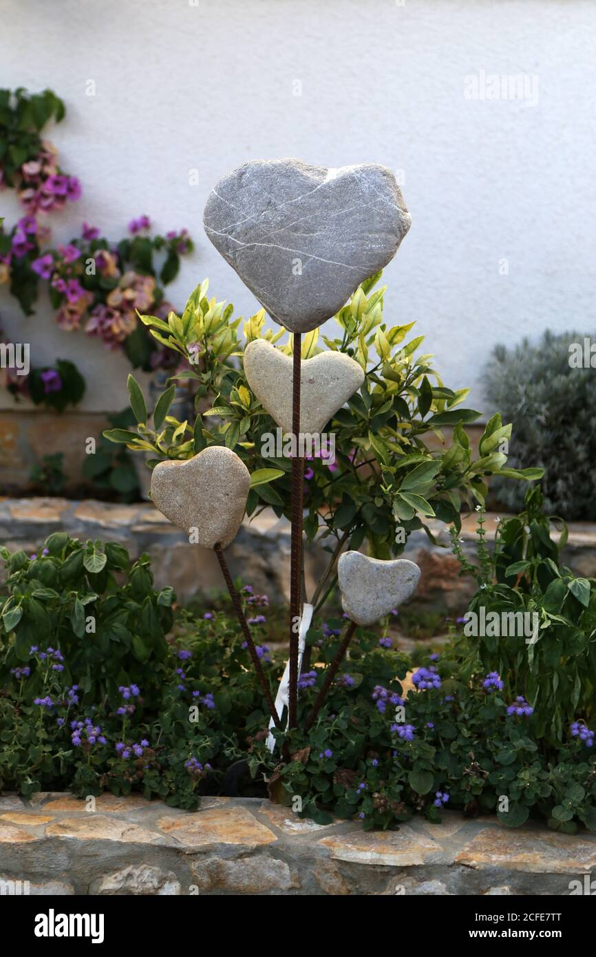 Decorative hearts of stones and metal in the garden Stock Photo