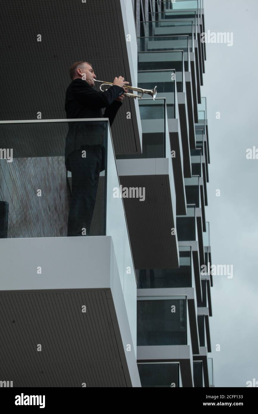 London UK 05 September 2020  Adam Wright (trumpet) from the Royal Philarmonica Orchestra surprised the neighborhood'scommunity and its visitors in Wembley  by playing the trumpet from a balcony overlooking the Spanish Steps in Wembley Credit: Paul Quezada-Neiman/Alamy Live News Stock Photo