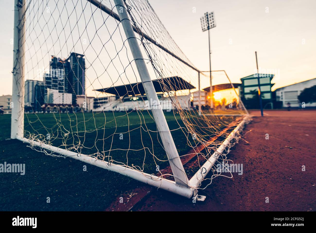goal football at sport stadium and sunset. Stock Photo