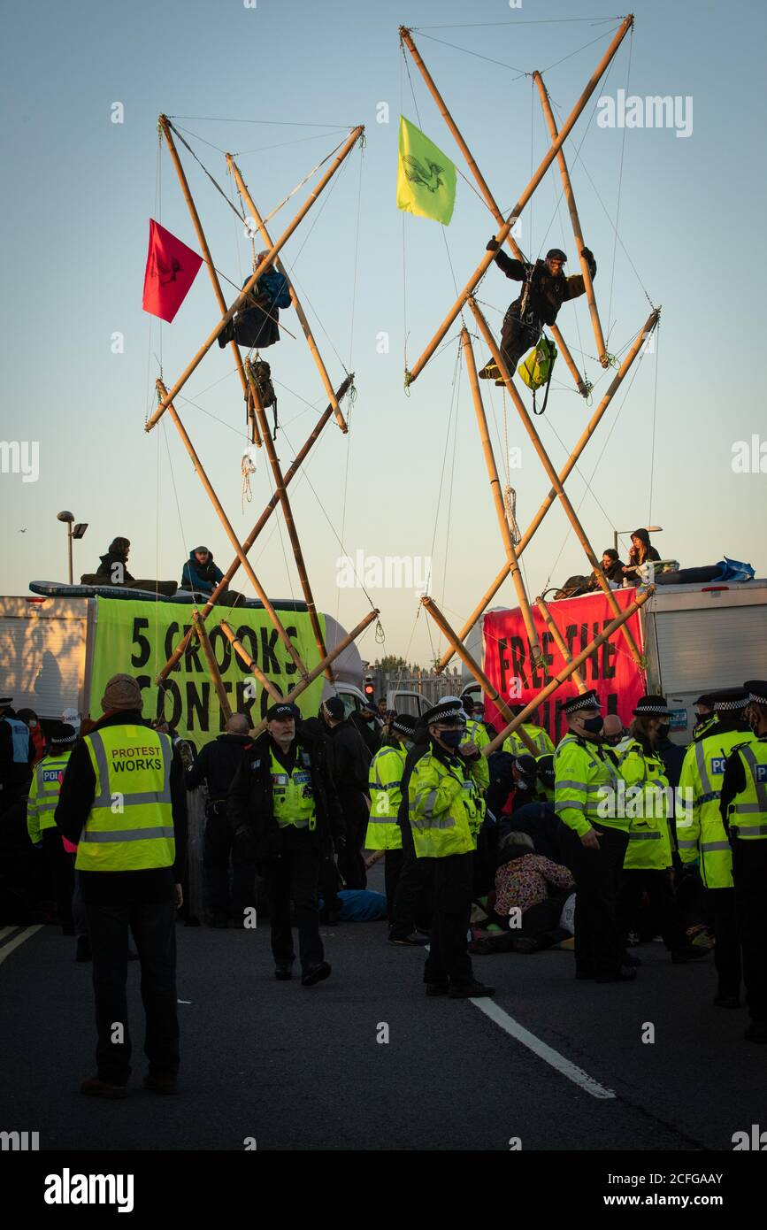 Extinction Rebellion carried out Non Violent Direct Action to blockade News International's printworks to protest ownership of UK by oligarchs and their failure to 'Tell The Truth' adequately report the scale of the Climate Crisis and their frequent support for Climate scepticism or denialism. Times, Telegraph, Sun, Mail & Evening Standard were all mostly unable to distribute print editions. Credit: Gareth Morris/Alamy Live News Stock Photo