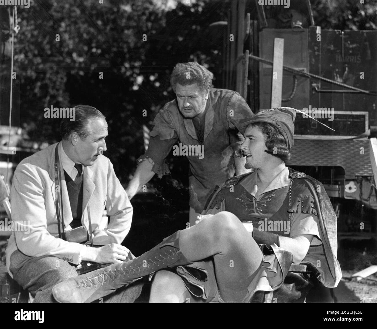 Director WILLIAM KEIGHLEY ALAN HALE and ERROL FLYNN on set location candid  in Chico California during filming of THE ADVENTURES OF ROBIN HOOD 1938  directors MICHAEL CURTIZ and WILLIAM KEIGHLEY music Erich