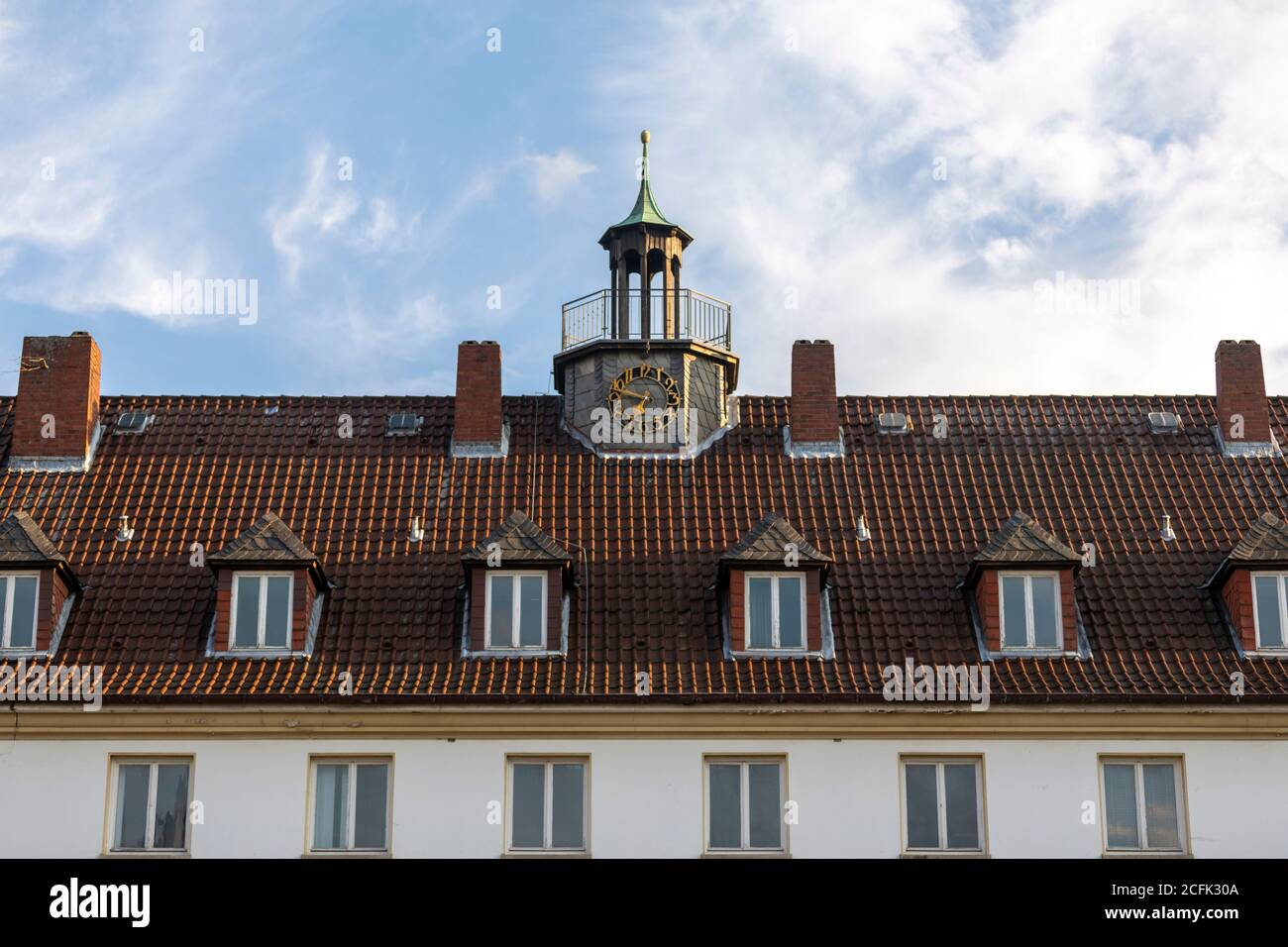 Rooftop and clockl tower of historical school building in Wolfsburg Stock Photo
