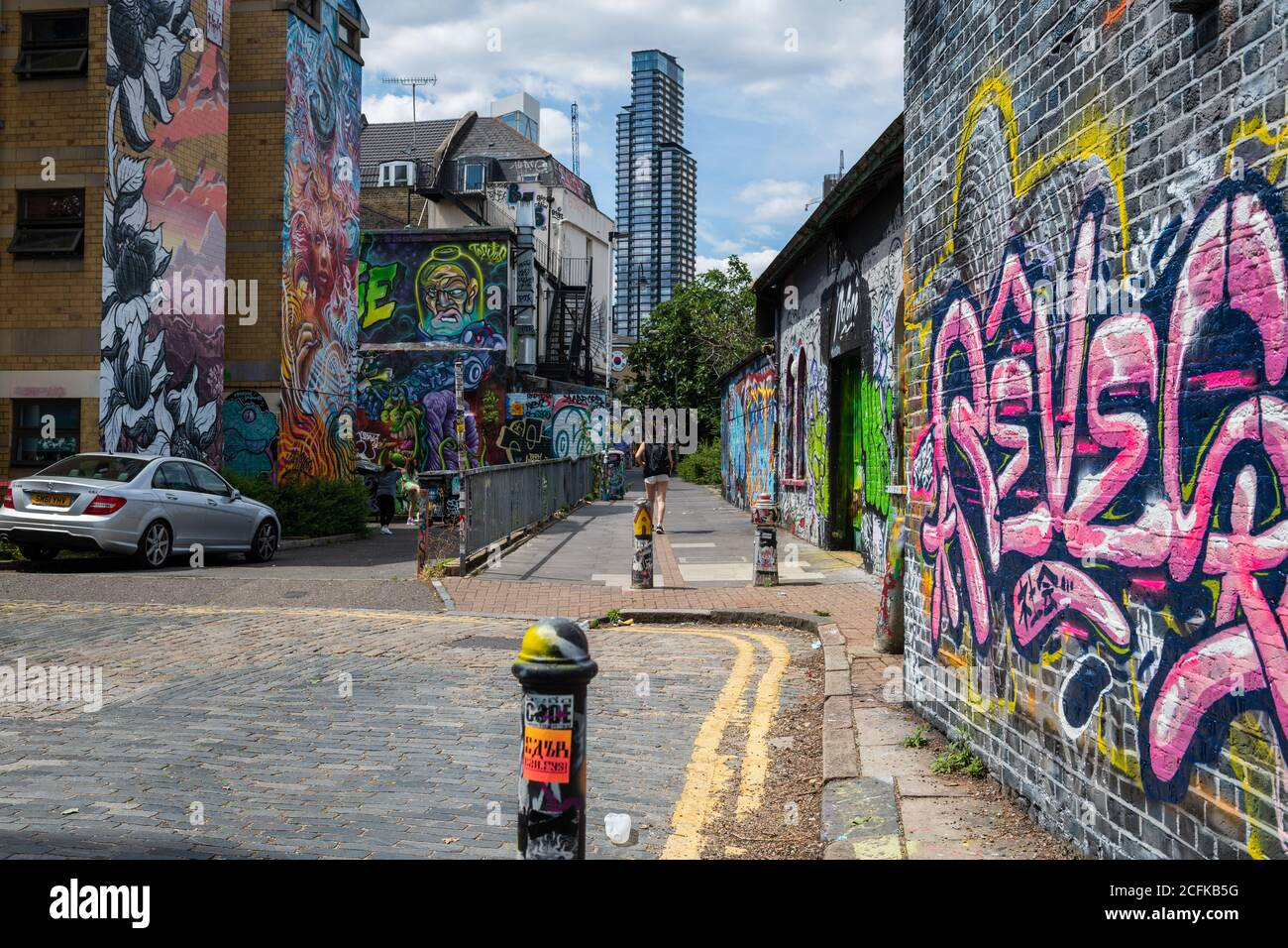 Shoreditch in the East End of London around Brick Lane have become a tourist attraction with its urban culture and numerous street art. Stock Photo