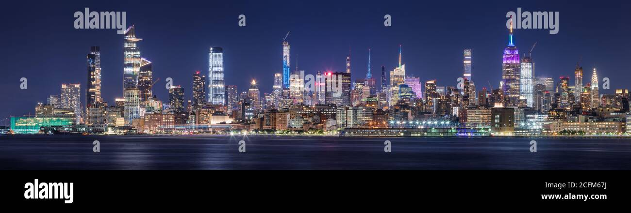 New York CIty panoramic cityscape of Midtown West skyscrapers at night along Hudson River Park. Manhattan, NY, USA Stock Photo
